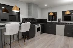 Kitchen space with dark cabinetry and hexagon backsplash