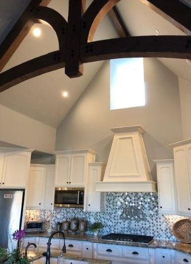 Michael Burt's Winning Design Kitchen with a High Ceiling and Large Stove Hood.