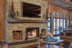 The quality can be seen in the way that textures like the woodwork on the walls contrast with the large stone of the fireplace surround.