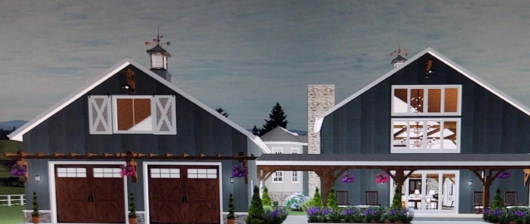 Large barndominium design with a covered front porch and silo living space.