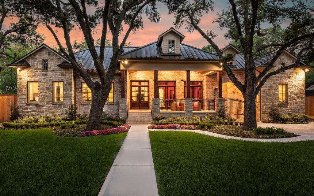 Home design with stone siding and cozy front porch.