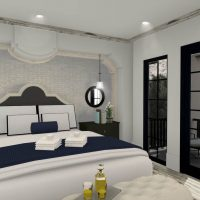 Grand guest bedroom with seating area and a private patio.
