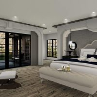 Grand primary bedroom with seating area and a private patio.