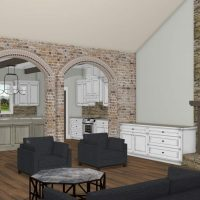 Open and bright living room with a fireplace and connected to the kitchen through arches.