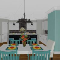 U-shaped kitchen design with waterfall island, pantry and is open to the dining space.