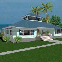 Ocean side beach house with lookout tower and detatched garage.