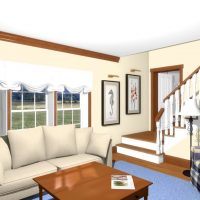 Living Room with ample seating and a staircase leading upstairs.
