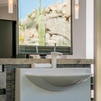modern white sink with mirror reflection showing view