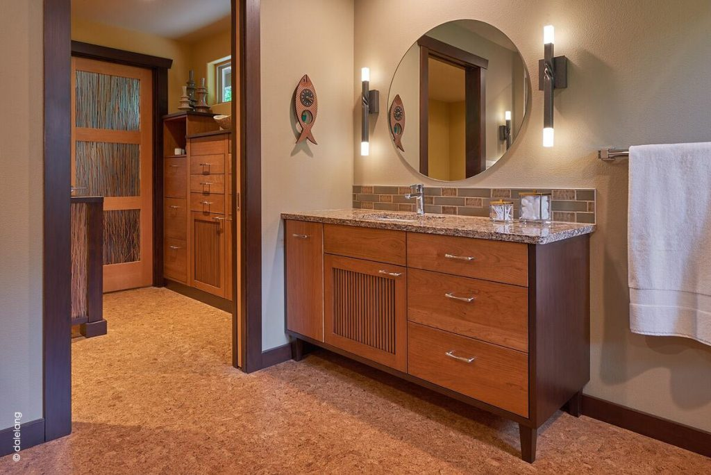 Photo of wood vanity and cork floor in large bathroom design by Robin Rigby Fisher