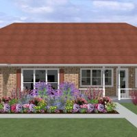 Rancher home design with brick siding and beautiful landscaping.