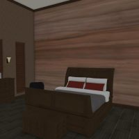 Bedroom with sleigh bed frame, tall ceilings and sliding barn door.