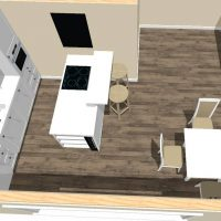 White kitchen design overview with natural wood flooring and custom island.