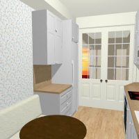 White kitchen design with built in eating area.