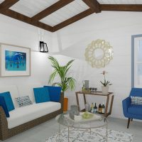 Coastal living room design with vaulted ceiling and exposed trusses.