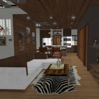 Rustic living room opens to kitchen and second story loft.