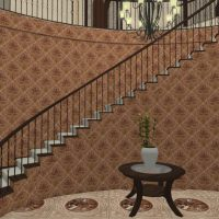 Grand entryway with wallpaper and curved stairway.
