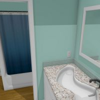 Green bathroom with custom vanity, decorative sink and tile.