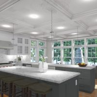 Kitchen design with two islands, white countertops, and grey cabinets, and lots of natural light.