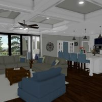 Open kitchen design leading to the living area. White cabinets contrast against the dark hardwoods.