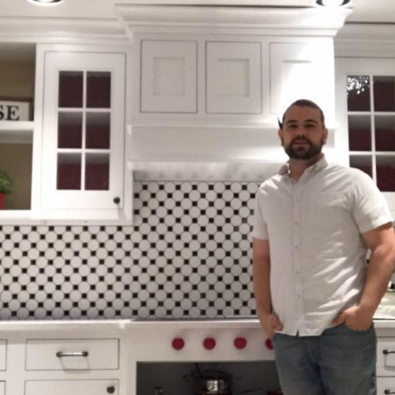 Chief Architect customer, Paul Machado., standing in front of his finished kitchen design