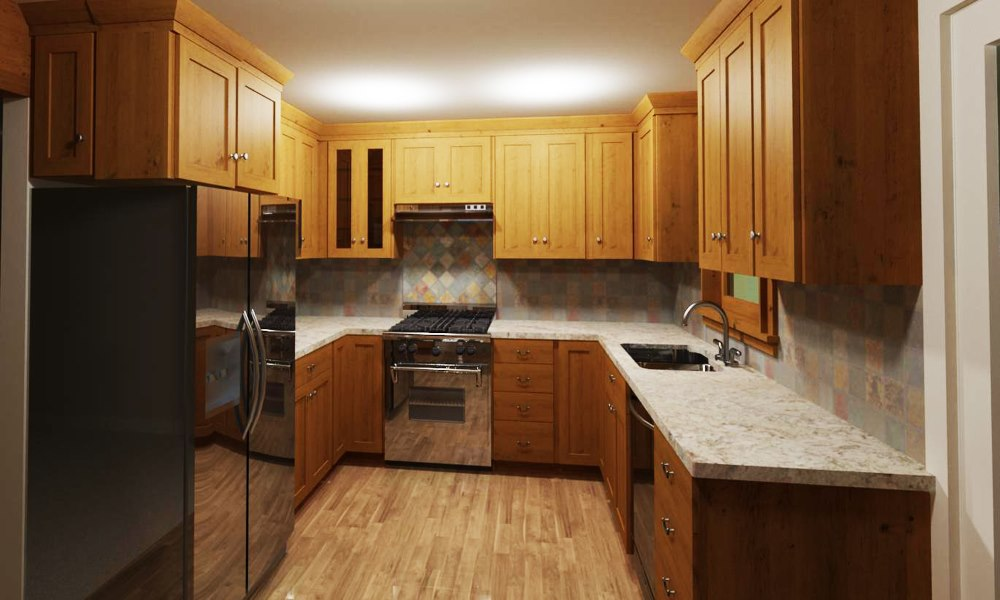 U-shaped kitchen with framed knotty wood cabinets and stainless steel appliances.