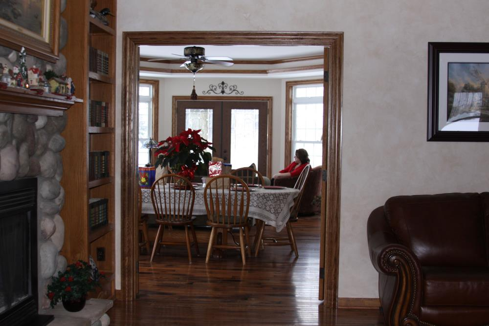 Looking through a doorway from the living room to the dining room.