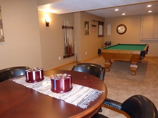 Game room with a pool table and area for board games. and cards