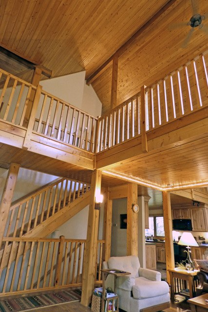 Staircase to a loft area within a log home.