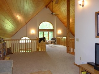 Loft with a vaulted ceiling.