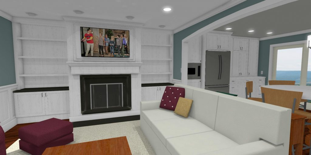 Living room with a fireplace, built in white cabinets, and opens into the dining room and kitchen.