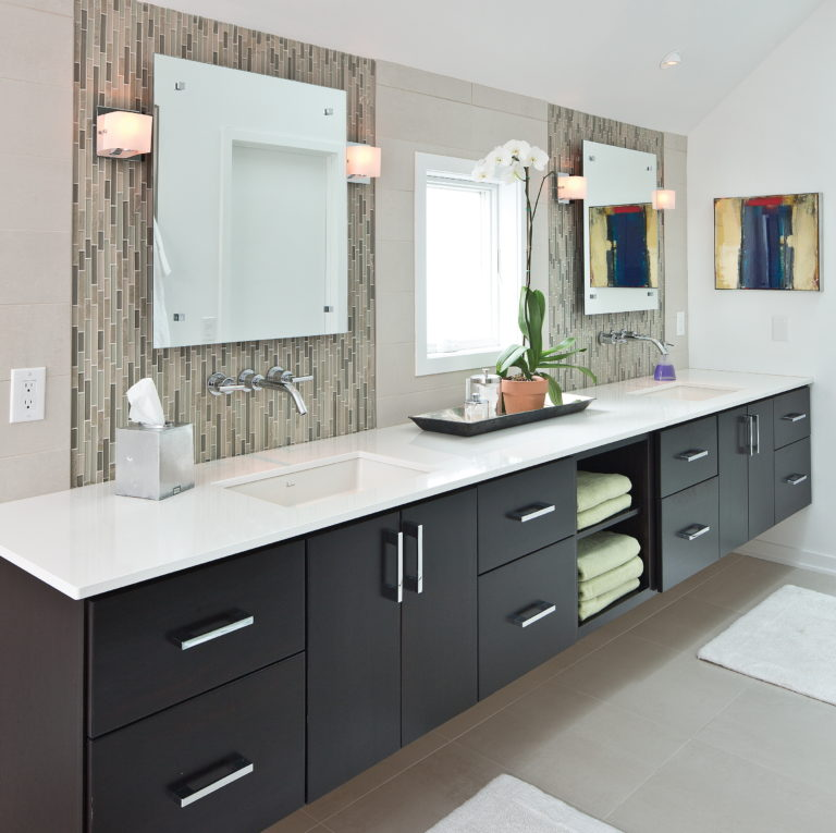 Accessible bathroom with dual vanity and floating cabinets.