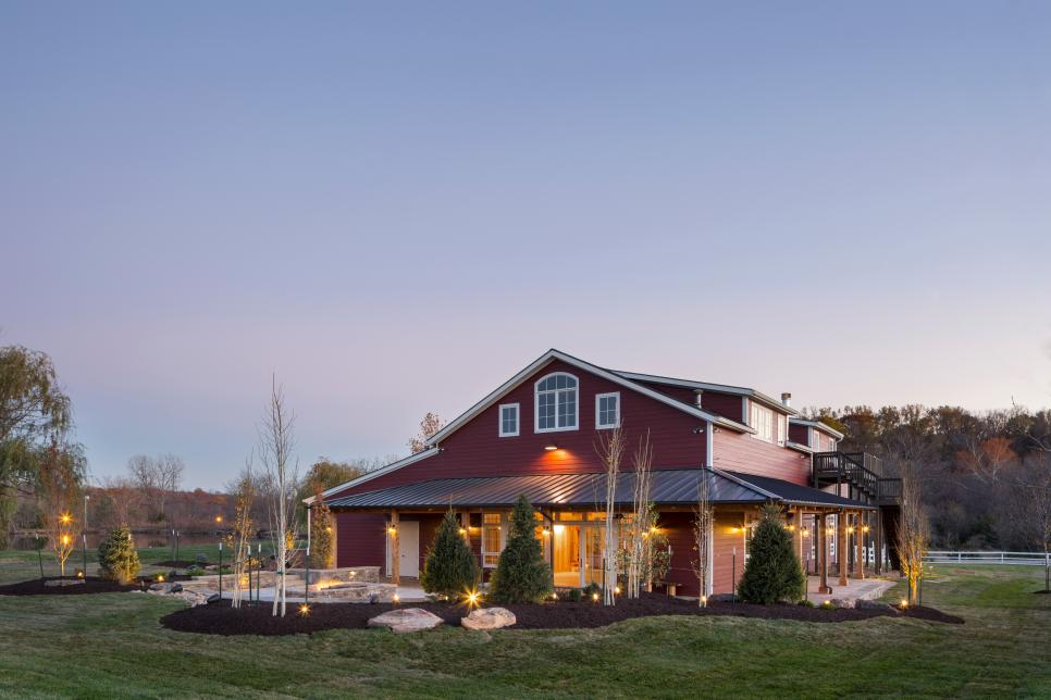 An exterior view of the red party barn designed by Kevin Transue of CHC Design Build.