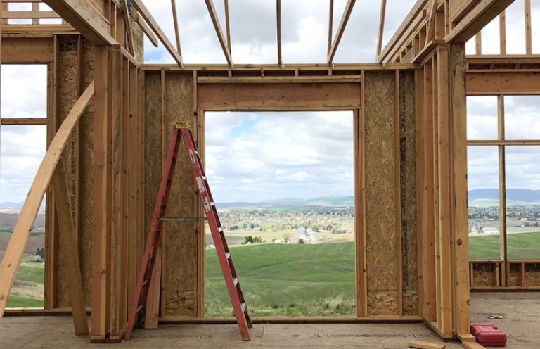 View of prarie from unfinished framed house