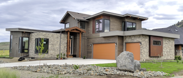 modern prairie style home surrounded by a golf course, desert hills and multiple views to Kamloops Lake