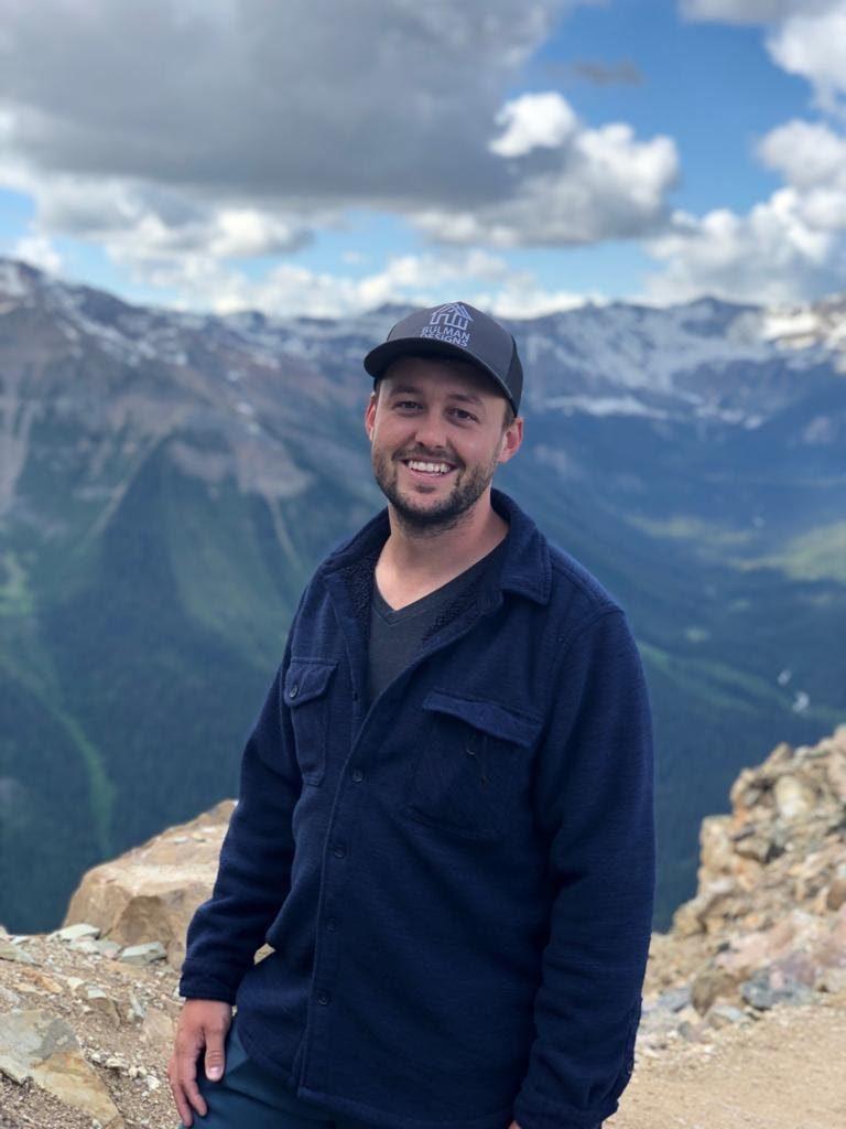 Photo of Sean Bulman standing on a mountain.