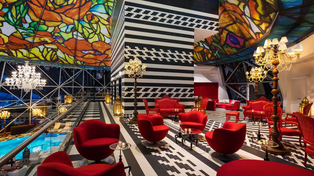 The maximalist interior of the Mondrian Doha Hotel's roof top pool.
