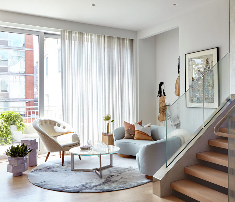 Feminine colors and soft shapes are a feature in this Chelsea NYC Triplex designed by INC Architecture & Design