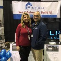 Man and woman standing side-by-side at tradeshow booth.