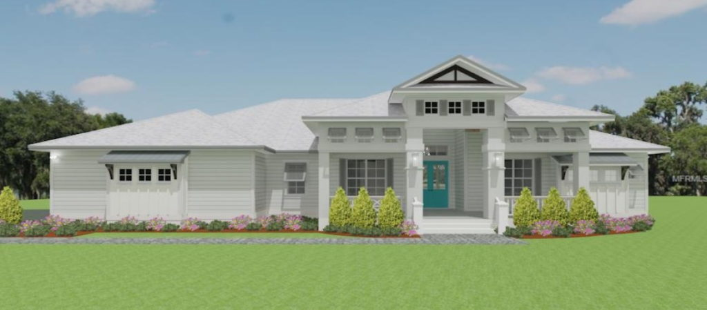 Front Rendering of Lake Home with grand entrance and landscaping.